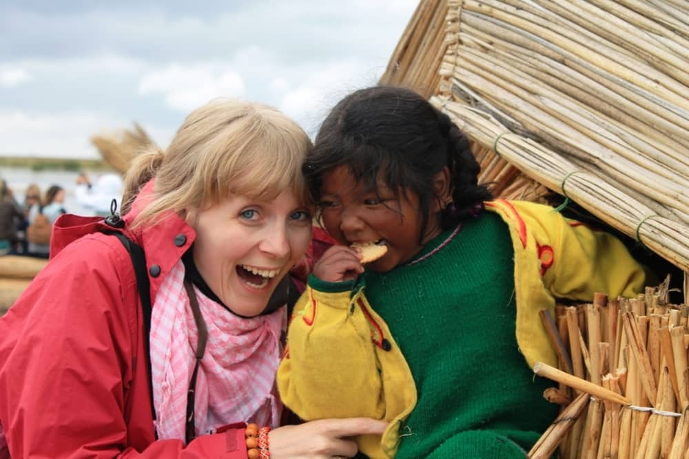 Tammy playing with an indigenous child in Peru